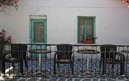 Old house with patio and furniture, Greek islands. Old house with sidewalk patio and outdoor furniture, Greek islands Royalty Free Stock Image