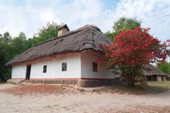 Old house of peasants. In the museum Pirogovo. Ukraine Stock Photos