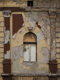 Old house with peeled paint  and window Royalty Free Stock Photo