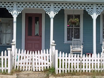 Old House with Porch. Old blue house with rocking chair on porch Royalty Free Stock Photography
