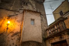 Old house in Porec town illuminated by lamp at the evening. Stock Images