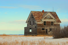 Old House on the Prairie. A battered, abandoned house sits empty. Tin roof, nice details. Was once a real beauty Royalty Free Stock Image