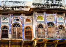 Old house, Pushkar, Rajasthan, India. Ruins of old traditional house with  colourful ceramic tiles and stained glass windows Royalty Free Stock Photo