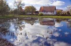 Old house reflected on lake Stock Photos
