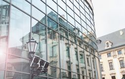 Old house reflection in modern glass building. Poland, Wroclaw Royalty Free Stock Photos