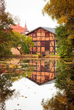 Old house with reflection in the pond Royalty Free Stock Photography