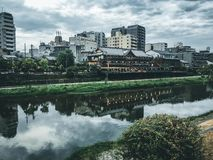Old house, restaurant and Kamo river at twilight, Gion, Kyoto, Japan stock images