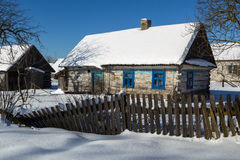 Old house and rickety fence in bellorussian village. Royalty Free Stock Photos