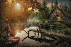 Old house by the river. The old house by the river backwater in a dense forest at dawn stock photography