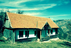 Old house in Romania. Old traditional house in a hilly area of Romania Stock Photography