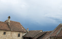 Old house roof. Old houses roof with approaching storm Stock Images