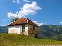 Old house. Old ruin house. Mountains, clouds Royalty Free Stock Images
