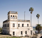 Old house in ruins. With windows on a sunny  day, with some palms tree in Bornos Stock Images
