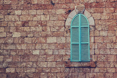 Old house's wall from jerusalem stone and old blue iron shutters Royalty Free Stock Images