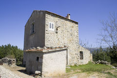 Old house in Sardinia. An old abandoned stone house in rural Sardinia. Horizontal Stock Photo