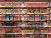 Old house in scaffolding Stock Images