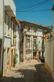Old house with scaffolding for refurbishment in an alley. Old house with scaffolding for refurbishment in the end of narrow alley, on sunny day at Castelo de royalty free stock images