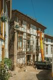 Old house with scaffolding for refurbishment in an alley. Old house with scaffolding for refurbishment in the end of narrow alley, on sunny day at Castelo de royalty free stock photos