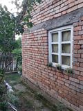 Old house in the serbian village. Wild beauty. mowed lawn. old plow royalty free stock images