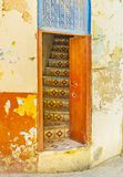The old building in Sfax, Tunisia. The old house with shattered paint on walls with a view on the tiled staircase through the open door, Sfax, Tunisia Stock Photography