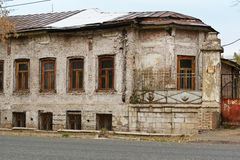 Old house on a side street. Fragment Stock Photos