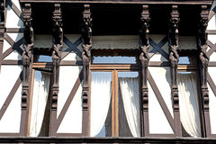 Old house with six devils. Six wooden devils are supporting the roof of this extravagant house Royalty Free Stock Image