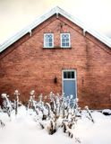 Old house in snow Stock Photo
