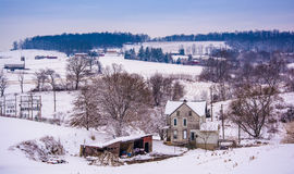 Old house and the snow covered landscape of rural York County, P Stock Photography