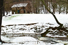 Old House/Snow/Creek Stock Image