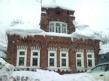 Old house. In snow town Stock Photos