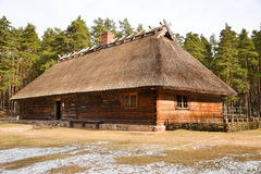Old house. An old house in a spring with a bit of snow on the ground Stock Photography