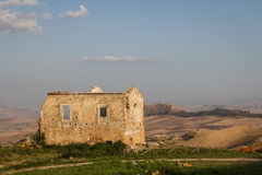 Old house standing over the ruins of the ancient city of Morgantina Royalty Free Stock Photography