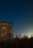 Old house star trails. 19 min total exposure of old house under moonlight Stock Photo