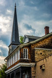 An old house and steeple of a chuch in Ellicott City, Maryland. Stock Images