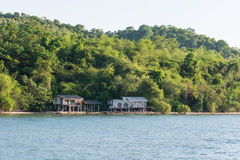 Old house on stilts over the sea Royalty Free Stock Images