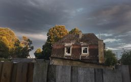 Old house in stormy weather. Photo shows old house and stormy weather Stock Image