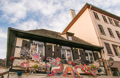 Old house in Strasbourg with red dragon decorations for christmas Stock Photography