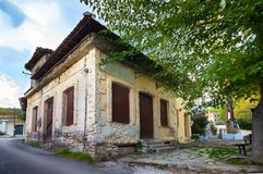 An old house on a street corner, Greece. Facade of a vintage old house in Metaxohori Village, Thessaly, Greece Stock Photography
