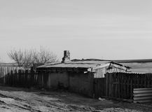 Old house on the street near tblack and white. Old house on the street near the lake.Astrakhan. Asia.black and white stock photos