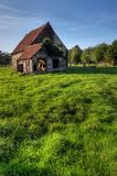 Old house in summer. Normandy traditional old house with fresh green grass meadow Royalty Free Stock Photo