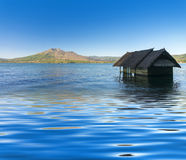 Old house sunk in batur lake Stock Photo