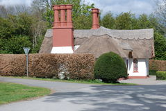 Old House with thatched roof Stock Photo