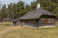 Old house with a thatched roof. Traditional housing of the indigenous populations of Estonia Stock Image