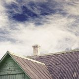 Old house with a tiled roof and chimney Stock Photo