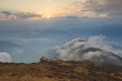 Old house on top of a mountain in the clouds Stock Images