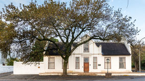 The old house by the tree. An old heritage Cape Dutch house built at the end of the 18th century in Stellenbosch, South Africa royalty free stock photos