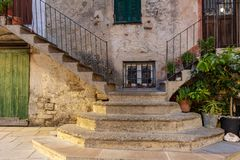 Old house of the tuscany. Detail of its narrow staircase to both sides. stock photos