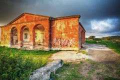 Old house under a dramatic sky Royalty Free Stock Images