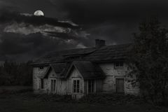 Old house under the moon stock image
