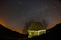 Old house under stars Stock Photo